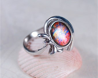 """Ammolite Ring.Extremely rare """"Tapestry""""pattern with some of ammolites rarest colours.Pink and purple.A true collectors ammolite."""