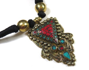 SJK Vintage -- Tibet or Nepal Bohemian Necklace With Brass Turquoise and Red Stone Chip Pendant, Black Wrapped Cord  (1970's-80's)