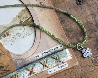 Balm Medic Cross Necklace with peridot