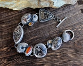 Reserved listing.......           Sterling silver, .  Turitellla agate, citrine, carnelian, ammonite fossil, eclectic statement bracelet.