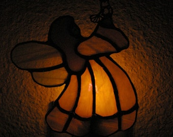 Stained Glass Night Light of a Pink and irridescent Pink glass Angel holding a bird.