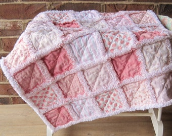 Pink rag quilted baby lovey with flannel batting and backing. Fluffy clipped seams. 24 inches square. Small quilt.