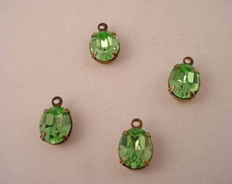4 Vintage glass Swarovski  Peridot oval  10x8 closed back brass ox charms 1 ring