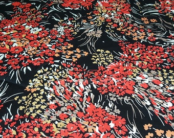 vintage 80s cotton fabric, featuring stylized floral bouquet print in black and red print, 1 yard, 2 available, priced per yard