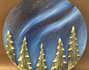 """HAND CARVED trees on panel wall hanging....18"""" diameter."""