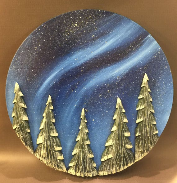 "HAND CARVED trees on panel wall hanging....18"" diameter."