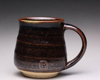 handmade pottery mug, ceramic teacup, coffee cup with black tenmoku and green celadon glazes