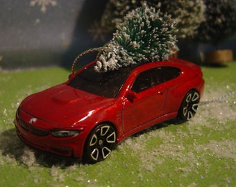 BMW M4 red car with Christmas tree ornament