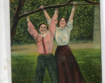 A pair of suspenders,  Couple hanging from tree vintage post card