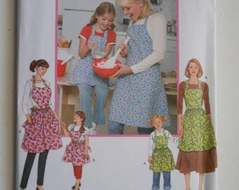 Mother and Daughter Full Apron Pattern Simplicity 3949 Size 3 4 5 6 7 8 10 12 14 16 18 20 Bust 22 23 24 25 26 27 32 1/2 34 36 38 40 42 UNCUT