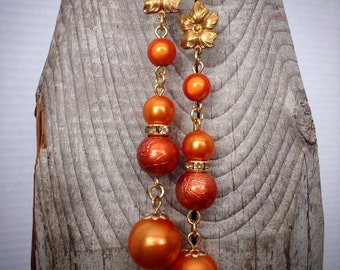 Gorgeous orange dangle earrings