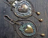 """Rustic asymmetrical sacred heart milagro earrings with gold leaf """"Hylopathism"""""""