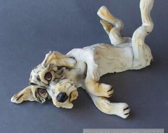 Cream Doodle Dog Lying on Back Whimsical Ceramic Sculpture