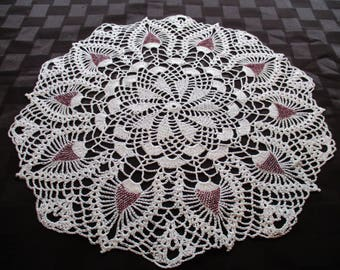 Crocheted white doily with burgundy beads