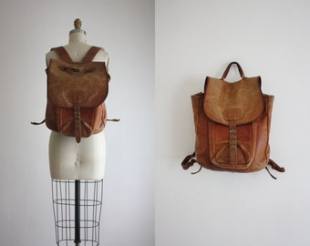 1960s distressed leather backpack