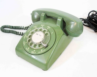 Vintage Green Rotary Telephone by Western Electric. Circa 1970's.