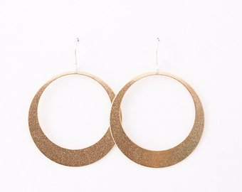 "Modern hoop earrings, sleek design and large size of these gorgeous earrings will make a statement anywhere - ""Lunar Hoops in Brass - Large"""
