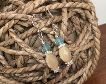Sterling silver, faceted mother of pearl, and Swarovski Austrian Crystal earrings