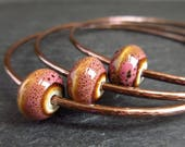 Skinny copper bangles with pink bead decoration, hammered bracelets, oxidized patina, copper wedding anniversary gift, 7th anniversary gift