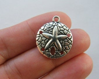 4 Sand dollar charms antique silver tone FF354