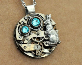 steampunk necklace ONCE Upon A TIME In WONDERLAND fairy tale inspired steampunk watch movement necklace with rabbit and wing