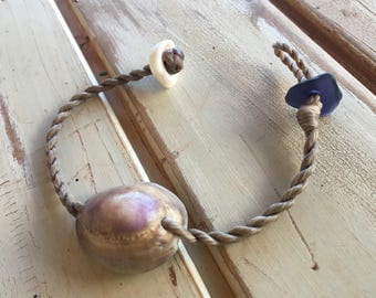 Purple cowrie with seaglass bracelet