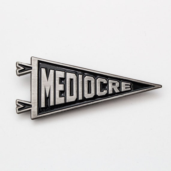 Mediocre enamel pin. Pennant lapel pin. Antique silver and black accessory.