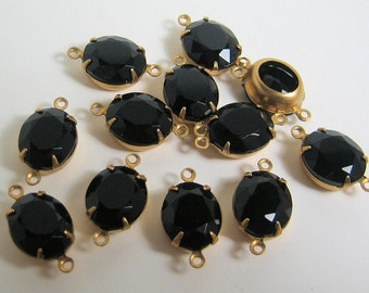 12 - 12x10 Black Glass Czech Ovals Mounted in 2 Ring Brass Prong Setting