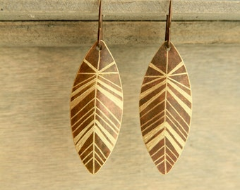 FEATHERED METAL. Brass and niobium hand etched brass feather earrings.