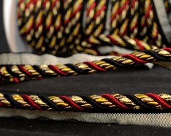 "3/8"" 401 274 Black Gold Red Lip Cord Trim"
