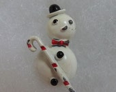 Vintage Christmas 1940s enamel snowman pin or brooch with jaunty candy striped cane, bow tie and fedora hat