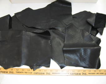 "Cowhide Leather Scraps, Black Duquessa (LS364) 364 grams between .055"" and .060"" thick large pieces"