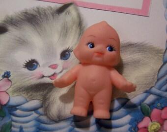 wee adorable little cute kewpie doll