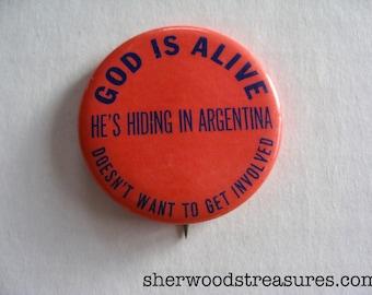 "Sixties  Original Hippie Free Love Era Button God Is Alive He's Hiding In Argentina Pinback Psychedelic Era Drugs 1 3/4"""
