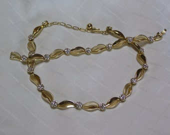 Crown Trifari gold tone vine links and clear sparkling rhinestone clusters necklace and bracelet