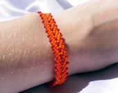 Woven Red and Orange Beaded Bracelet