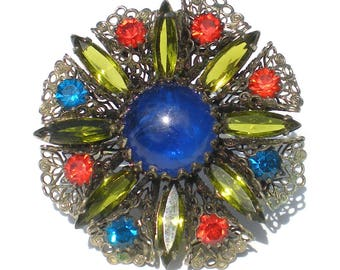 Rhinestone Flower Brooch with Art Glass Swirled Blue Cabochon with Red Orange and Green Rhinestones with Filigree - Vintage Jewelry