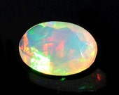 ON SALE 55% Huge Ethiopian Opal, Faceted Opal, Cut Stone, Faceted Cabochon, Fire Opal, 6x8mm, 0.85CTW - O/53