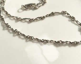 Love Knot Handmade Chain In Sterling Silver by JeanineDesigns