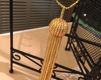 Gold beaded tassel necklace  with 9 karat gold plated chain no flaws