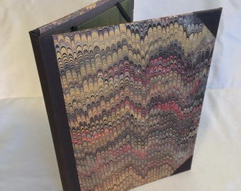 iPad Air case.  Made from new and recycled materials, with marlbed paper cover