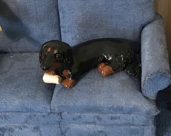 Long hair Black and Tan dachshund with bone toy polymer clay sculpture