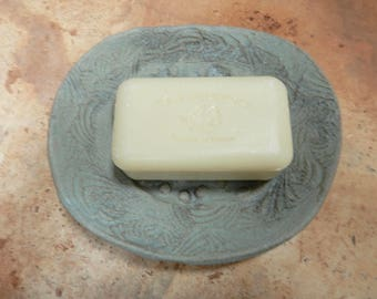 Pottery soap dish made of stoneware clay…..organic in nature…...rustic..very matte cement  grey blue glaze