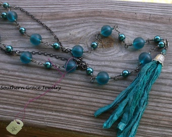 Long blue glass beaded necklace with silk tassel