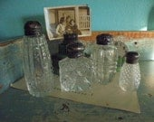 Collection of four pretty cut glass shakers with aged silver tops