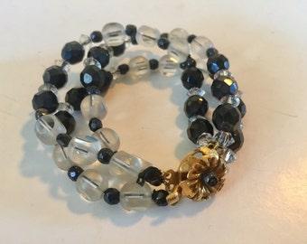 Pretty Gold Tone Metal Black Glass and Clear Crystal Three Strand Bracelet