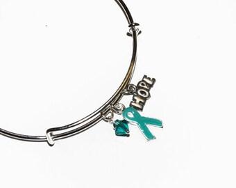Teal Awareness charm bracelet. Ovarian Cancer, Anti-Bullying, PTSD, Cervical Cancer, Myasthenia Gravis,Cervical Cancer. Bangle bracelet