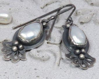 Silver earrings with fresh water pearls and cut out lace pattern