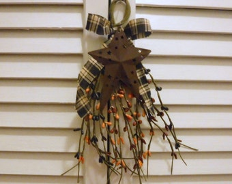 """9"""" long pip swag with plaid bow and a rusty star on it primitive hanger"""