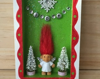 Troll Angel Holiday - small wood diorama. Red haired troll doll angel. White, red, and green. Spread some JOY!